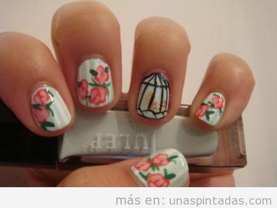 Diseño de uñas con dibujos vintage de rosas y jaula de pájaro