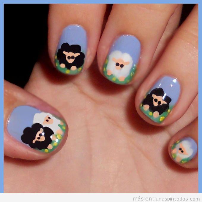 Diseño de uñas con sencillos dibujos de ovejas