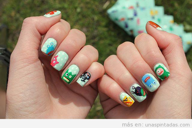 Nail Art o decoración de uñas con dibujos de pequeños monstruos