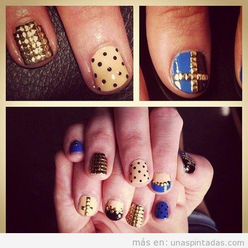 Diseño de uñas con lunares y tachuelas en dorado y azul