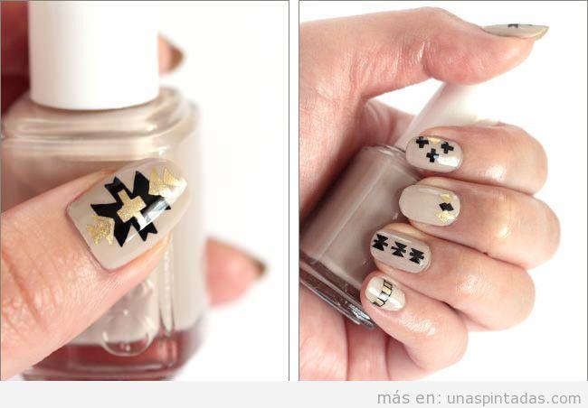 Diseño de uñas elegante y sofisticado que combina colores nude, dorado y negro