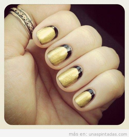 Decoración de uñas en oro y negro