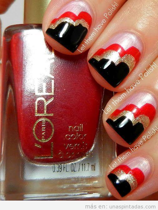 Decoración de uñas con formas onduladas en negro, rojo y dorado