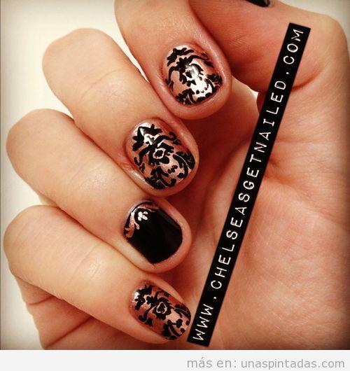 Decoración de uñas estilo Barroco en negro y dorado