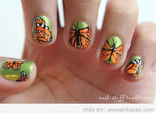 Diseño de uñas con increíbles dibujos de mariposas negras y naranjas