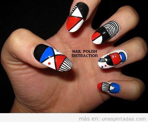 Decoración de uñas inspirada en un graffiti colores azul, blanco rojo y negro