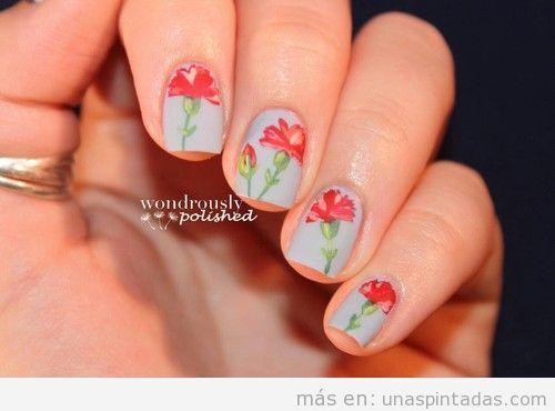 Diseño de uñas con un clavel dibujado