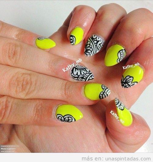 Diseño de uñas para verano 2013 en amarillo neón y dibujos en blanco y negro