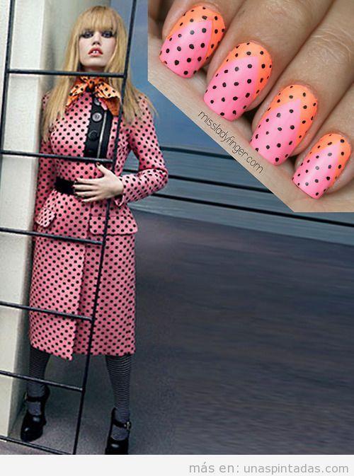 Diseño de uñas de color rosa y naranja con lunares en negro