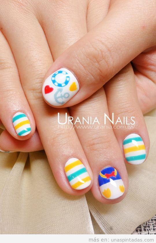 Diseño de uñas a rayas y con dibujos para el verano