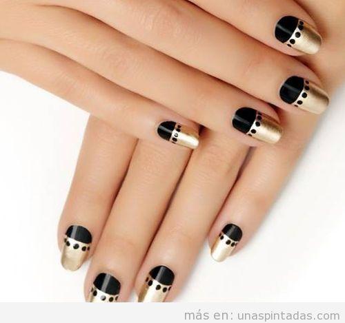 Uñas pintadas bonitas de negro con dorado