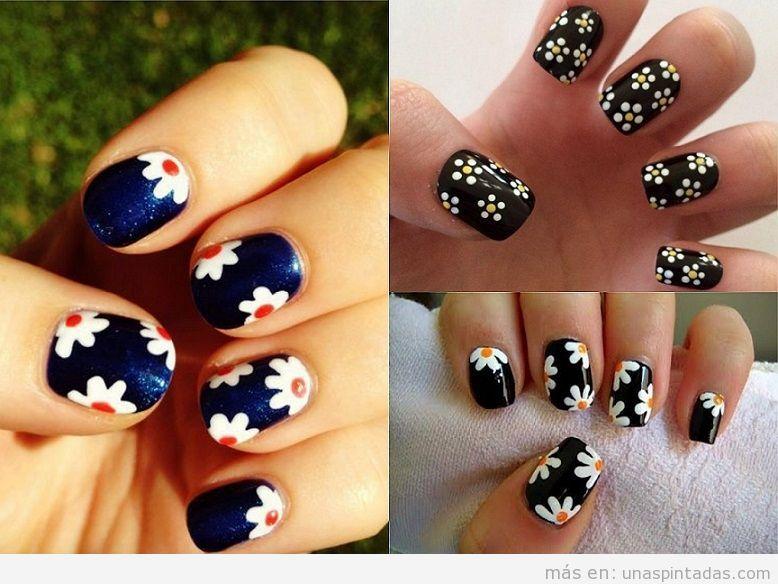 Decoración de uñas con dibujos de margaritas y fondo oscuro