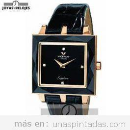 Reloj de mujer negro y dorado